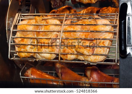 Grilled chicken in oven close up view
