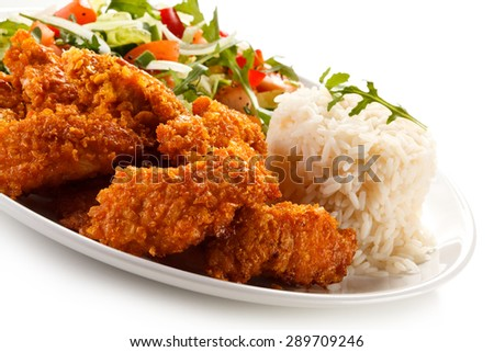 Grilled chicken nuggets and vegetables  - stock photo