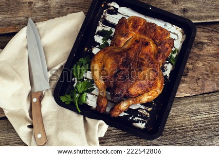 Grilled chicken on the table - stock photo