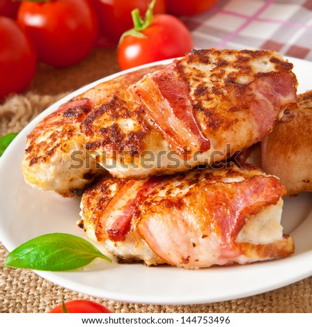 grilled chicken patties wrapped strips of bacon - stock photo