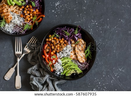 comment rester en bonne santé - Page 4 Stock-photo-grilled-chicken-rice-spicy-chickpeas-avocado-cabbage-pepper-buddha-bowl-on-dark-background-587607935