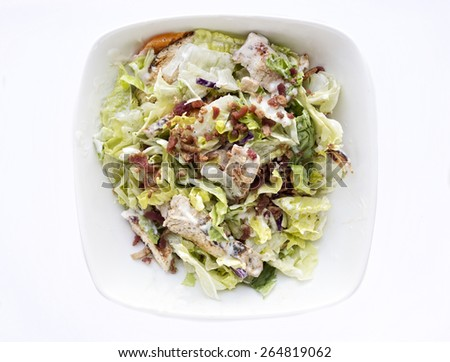 Grilled chicken salad with lettuce and bacon in a creamy dressing. - stock photo