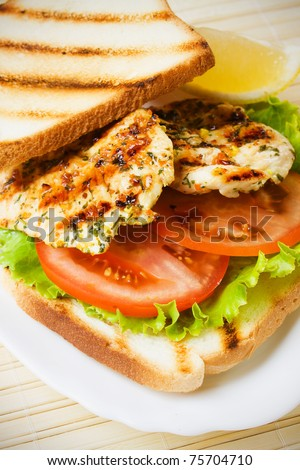 Grilled chicken sandwich with tomato and lettuce - stock photo