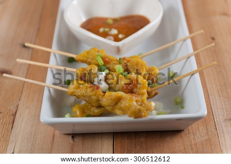 Grilled chicken satay with peanut sauce,Traditional Thai barbecue roasted chicken.Selective focus. Very shallow Depth of Field, for soft background. - stock photo