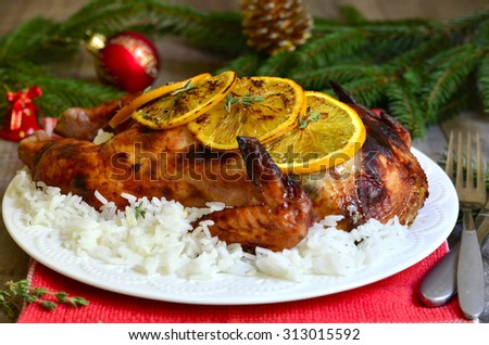 Grilled chicken stuffed with dried fruits in honey and orange glaze on festive background. - stock photo