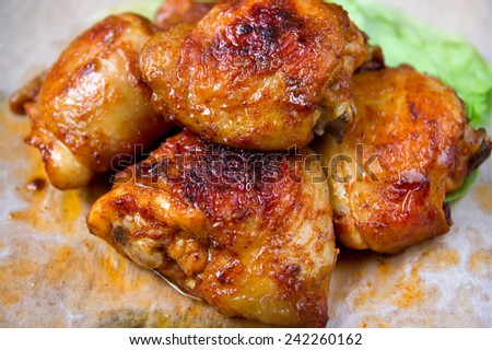 Grilled chicken thighs - stock photo