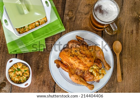 Grilled chicken whole and stuffed with herbs and nettles, czech beer - stock photo