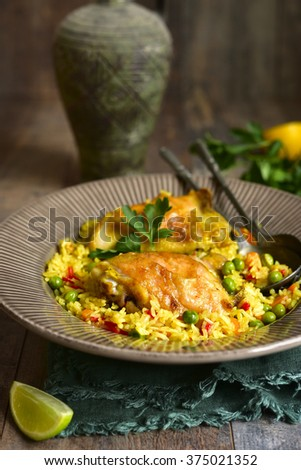 Grilled chicken with fried rice and vegetables on wooden table. - stock photo