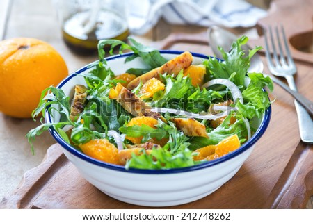 Grilled chicken with orange salad by balsamic dressing - stock photo