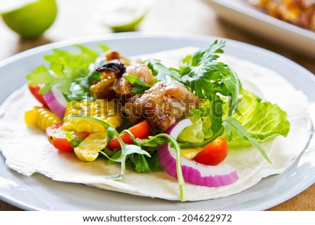 Grilled chicken with sweet corn and vegetables Tortilla - stock photo