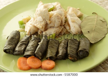 grilled chicken with vain leaves - stock photo