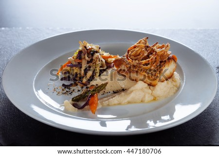 grilled cod fish with mashed potatoes and vegetables/Portuguese dish