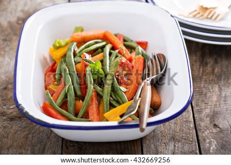 Grilled colorful vegetable side in a pan with green beans, carrots and bell peppers - stock photo