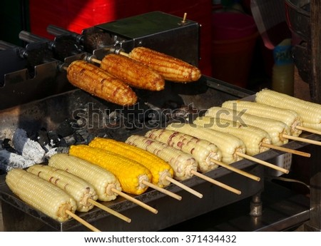 Grilled corn cobs with barbecue sauce are a popular street food in Taiwan