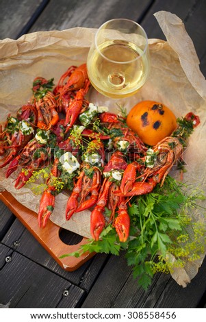 Grilled crayfish with herbs, cheddar and feta cheese - stock photo