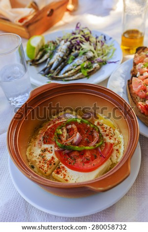 Grilled feta cheese, traditional Greek dish - stock photo