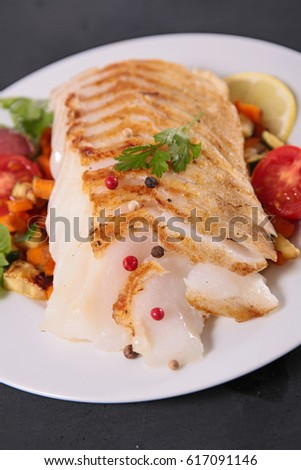 grilled fish fillet and vegetables