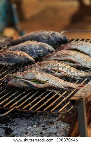 Grilled fish, fish, food, burning. - stock photo