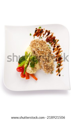 grilled fish sprinkled with breadcrumbs isolated on white. - stock photo