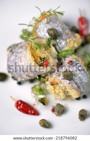 grilled fish with asparagus, pea, yellow peppers, carrots and spring onions on white plate - stock photo