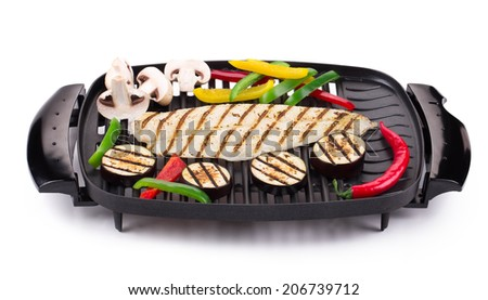 Grilled fish with vegetables isolated on white background