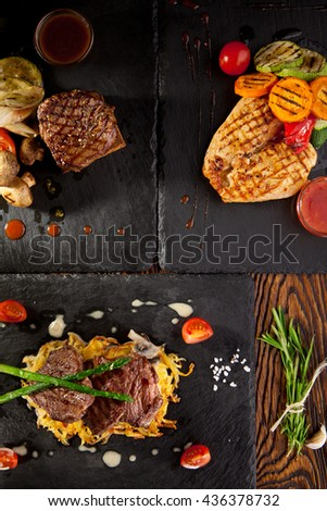 Grilled Foods - Beef Steak and BBQ Chicken with Various Garnish - stock photo