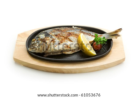Grilled Foods - Grilled Fish with Lemon and Cherry Tomato - stock photo