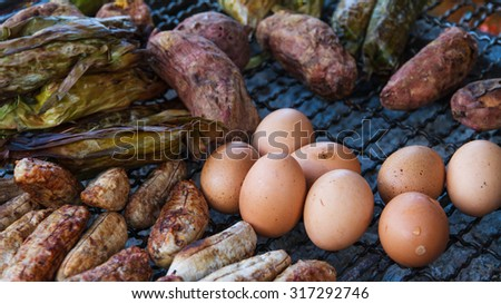 Grilled fresh foods on steel grating - stock photo