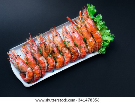 Grilled Giant River Prawn on black background - stock photo