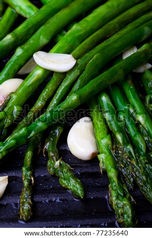 grilled green asparagus and garlic - stock photo