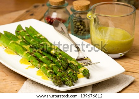 Grilled green asparagus with sauce - stock photo