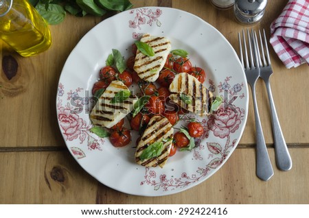 Grilled halloumi and tomato salad - stock photo