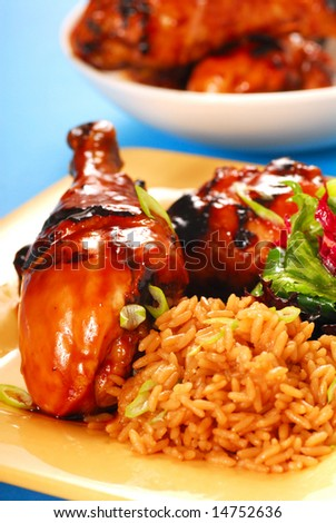 Grilled honey and balsamic glazed asian chicken with brown rice and salad - stock photo