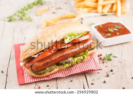 Grilled hot dogs with ketchup on a picnic table - stock photo