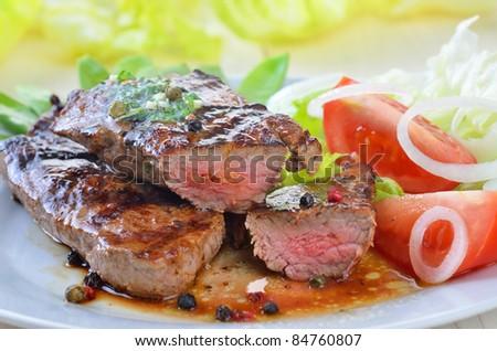 Grilled juicy beefsteak - stock photo