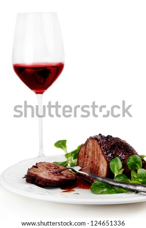 Grilled juicy fillet of beef with glass of red wine - stock photo