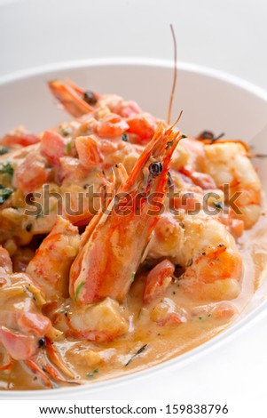 grilled king prawns in sauce - stock photo