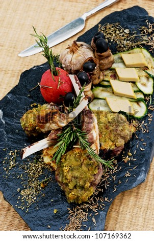 Grilled lamb chops with curry sauce on heat stone. - stock photo