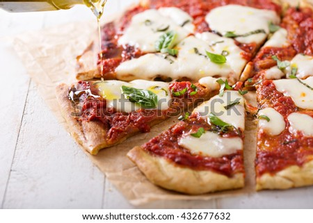 Grilled Margherita pizza with tomato sauce, olive oil, basil and mozzarella - stock photo