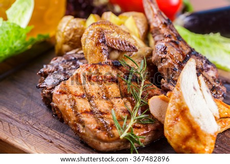 Grilled meat and potato - stock photo