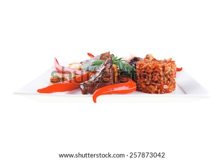 grilled meat chunks on white plate over white - stock photo