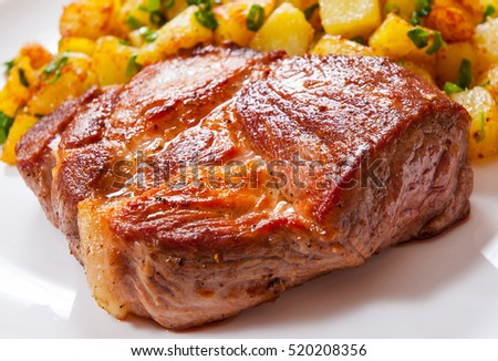 grilled meat fillet steak with fried potato in a plate