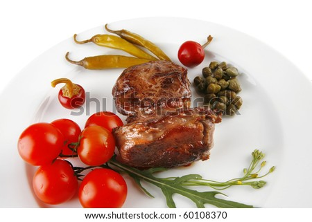 grilled meat medallion served with white on red