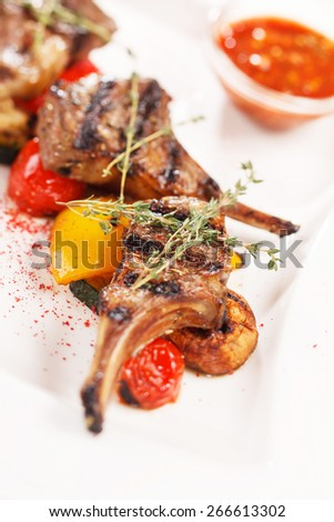 grilled meat ribs with vegetables - stock photo