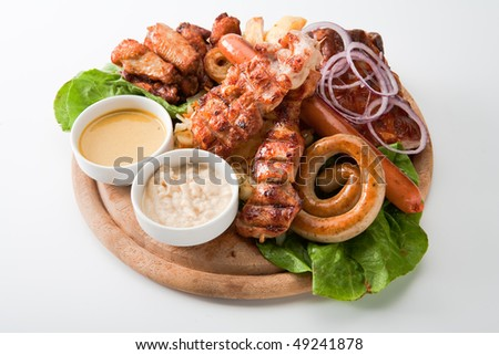grilled meat sausages on pita bread with vegetables - stock photo