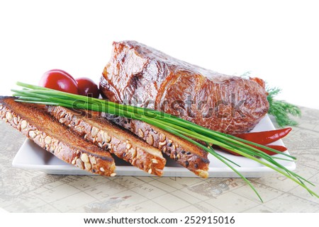 grilled meat served with vegetables and bread - stock photo