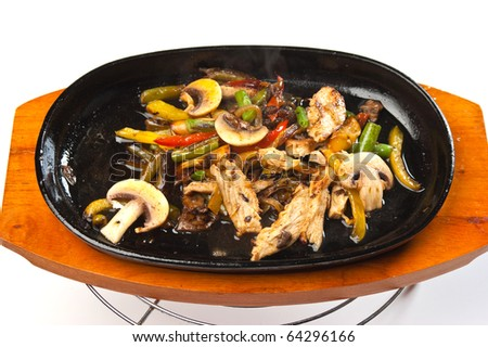grilled meat with mushrooms and vegetables in a boiling pan