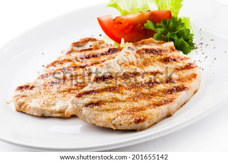Grilled meat with vegetable salad  - stock photo