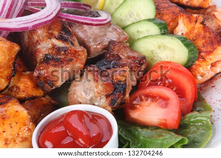 Grilled meat with vegetables - stock photo