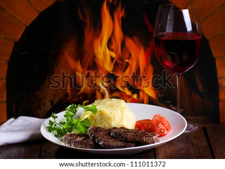 grilled meat with vegetables and glass of wine - stock photo